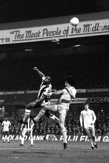 West Bromwich Albion's Cyrille Regis (left) battles for the ball with Tottenham