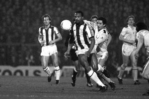 West Bromwich Albion's Cyrille Regis shields the ball from Tottenham Hotspur's